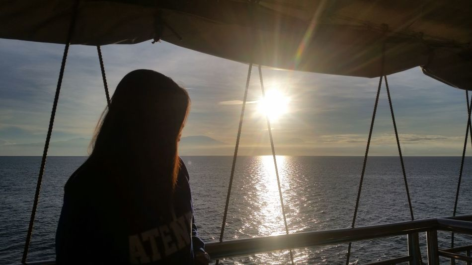 Sea Sun Only Women Sunlight One Person Water Sunbeam Horizon Over Water One Woman Only Tranquility Vacations Travel EyeEm Gallery EyeEm Best Shots Eyeem Philippines EyeEm Cagayan De Oro City Sunshine Morning Light Tourist Ship Sunrise Mobile Photography