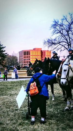 Full Length Outdoors People Sky Day Men Police Horses Police At Work Real People Large Group Of People Street Photography City Life Demonstration Marching Signs, Signs, & More Signs Irwin Collection EyeEm Best Shots Horses Sunset Resist By ICP Resist! The Photojournalist - 2017 EyeEm Awards