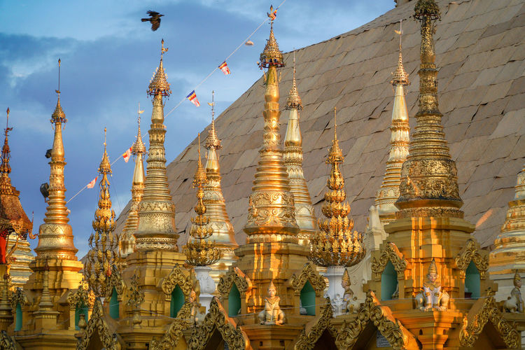 Outdoors Place Of Worship Spirituality Religion Buddhism Architecture Pagoda Shwedagon Pagoda Travel Destinations Gold Colored Tower Tourism Travel Spire  Ornate Large Group Of Objects Built Structure Belief