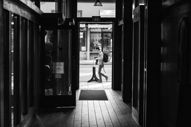 Leisure Activity Full Length Lifestyles Architecture Built Structure Building Casual Clothing City Day Paving Stone Footpath The Way Forward Blackandwhite