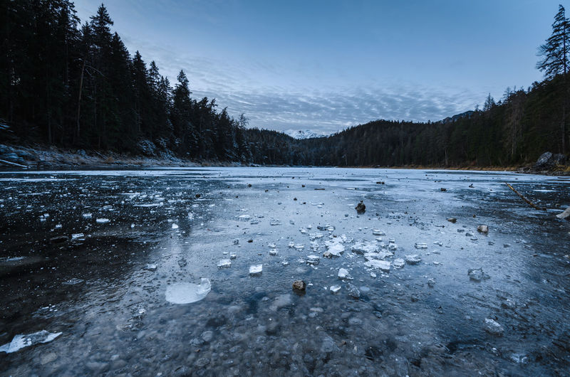 Surface level of frozen lake against sky