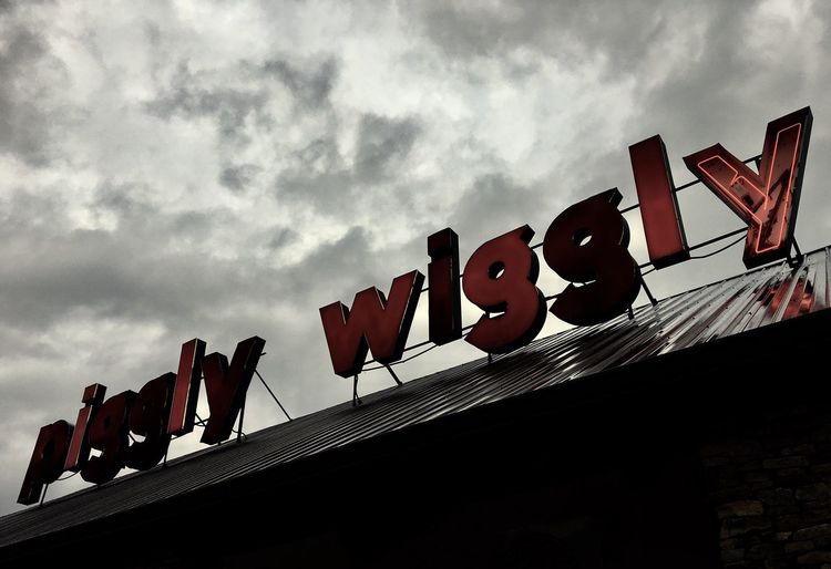 About to rain. Low Angle View Sky Architecture Stormy Weather Piggly Wiggly Neon Sign Disrepair