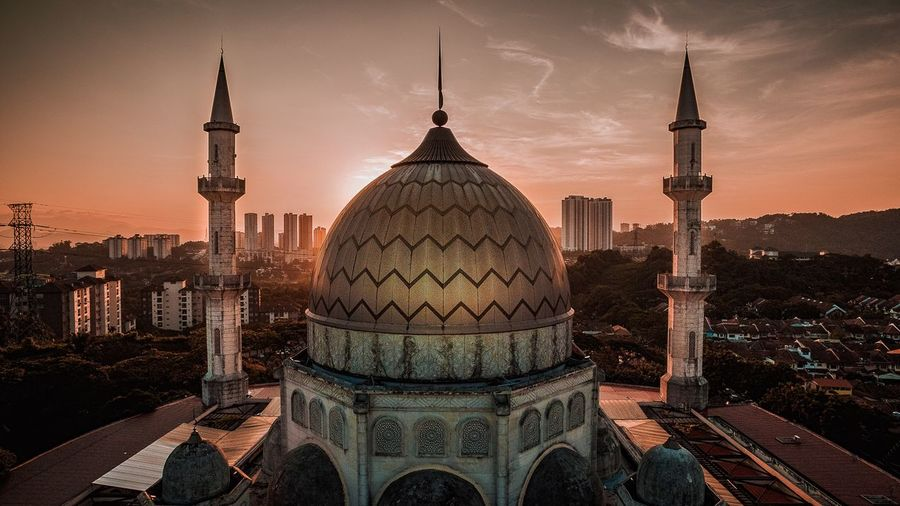 Beautiful Mosque during Sunrise Architecture Travel Destinations Built Structure Building Exterior City Travel Tourism Dome Illuminated Sky Skyscraper Sunset Outdoors Night No People Cityscape