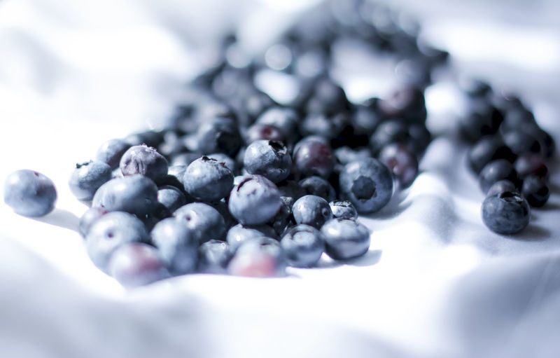 Close-up of blueberries on fabric