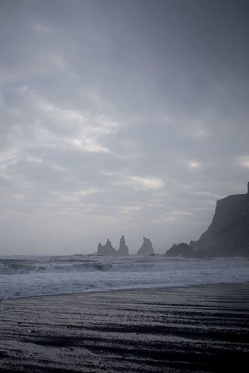 Black sand beach at Vik, Iceland Beach Beauty In Nature Cloud - Sky Coastline Horizon Over Water Iceland Idyllic Nature Outdoors Remote Reynisdrangar Sand Scenics Sea Shore Sky Tranquil Scene Tranquility Vik Water Waterfront Wave