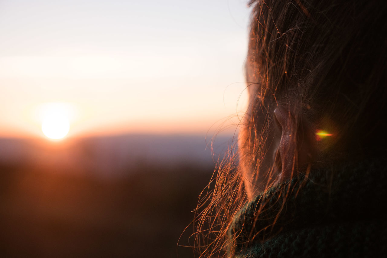 Cropped Image Of Woman Against Sky During Sunset