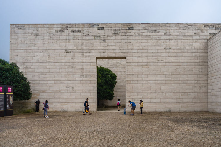 Group of people against wall