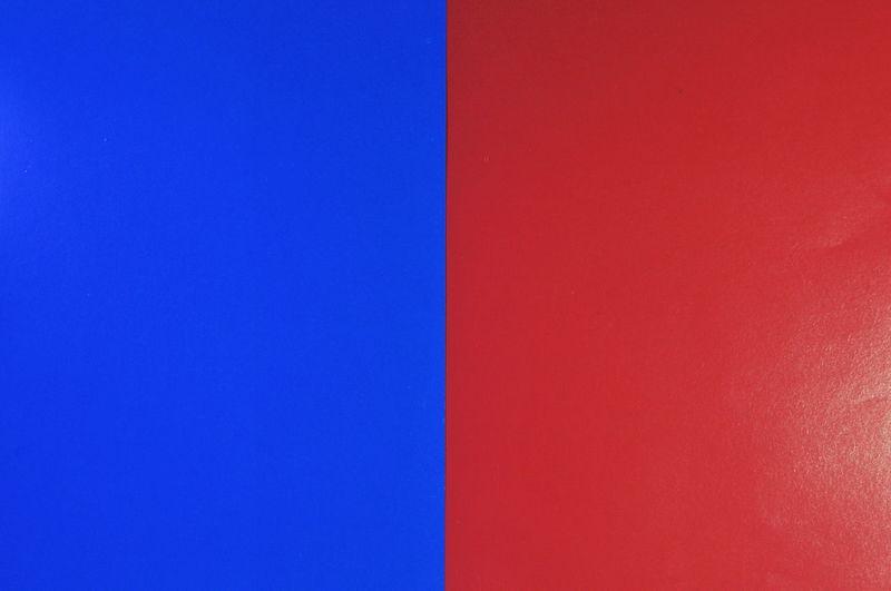 Full frame shot of multi colored wall against blue sky