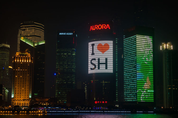 illuminated skscrapers at Pudong Aurora Huangpu I❤️SH Shanghai Shangri-La Architecture Building Exterior Built Structure City Cityscape Communication Illuminated Long Exposure Modern Neon Night No People Outdoors Pudong Sky Skyscraper Text Citylights Tungsten  Reflection