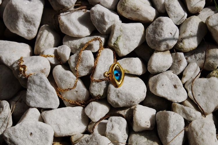 Fatima eye jewelry Stone Necklace Gold Jewelry Eye Fátima Beach Full Frame Sand No People Backgrounds Nature Pebble Day Outdoors Close-up Animals In The Wild Beauty In Nature Sea Animal Themes Sea Life Pebble Beach EyeEmNewHere
