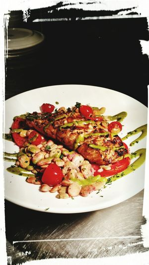 Salmon &Tomato plated with Butter Beans and a Basil Dressing
