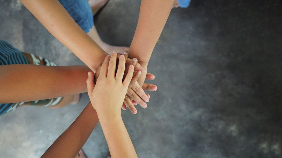 Young children join hands to best friendship forever, collaboration of business and education teamwork concept for backgrounds Human Body Part Human Hand Real People Body Part Togetherness Hand Lifestyles People Child Childhood Low Section Midsection Group Of People Leisure Activity Indoors  Adult Human Limb Togetherness Friendship Team Teamwork Success Friends Business Education Joy Memories Backgrounds Concepts