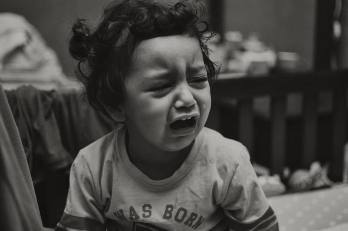 A girl crying Anger Child Childhood Cry Crying Distressed Emotions Focus On Foreground Frustration Girl Hunger Indoors  Jealous Missing You Moody Negative One Person Sad Sadness Syria  Tantrum Tears Toddler  Tragedy Unhappy