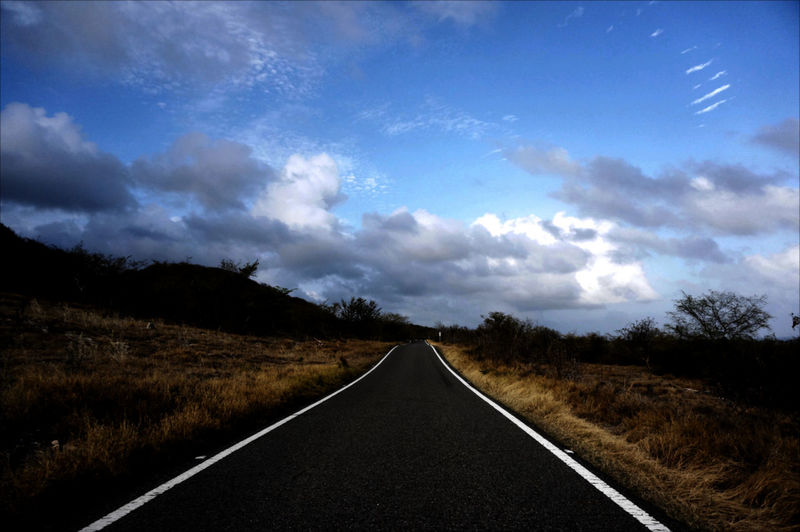 Beauty In Nature Cloud - Sky Dry Forest Empty Road Horizon Landscape Outdoors Road Road Marking Road To Ballena's Beach Scenics Sky The Way Forward Tranquil Scene Twilight