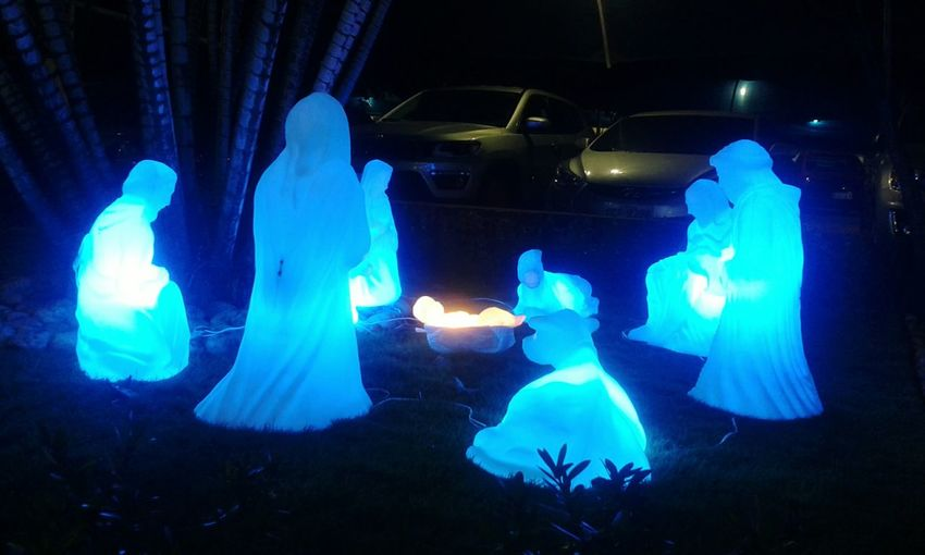 An illuminated Nativity scene Blue Illuminated Indoors  Adult People Night One Person Nativity Scene Jesus Christ Baby Jesus Religion