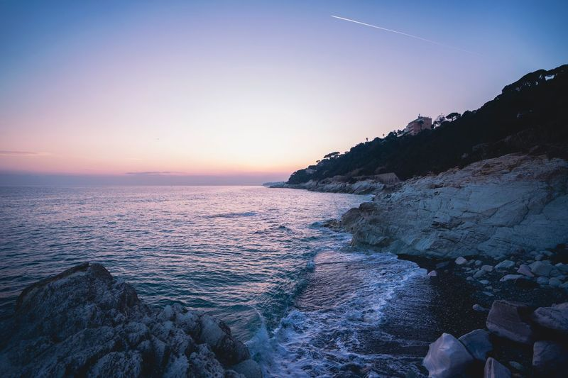 Sky Scenics - Nature Water Beauty In Nature Sea Tranquil Scene Tranquility Rock Non-urban Scene Outdoors Horizon Over Water No People Land Nature Horizon Idyllic Beach Mountain Sunset