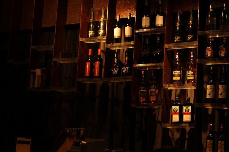 Row of wine bottles on shelf