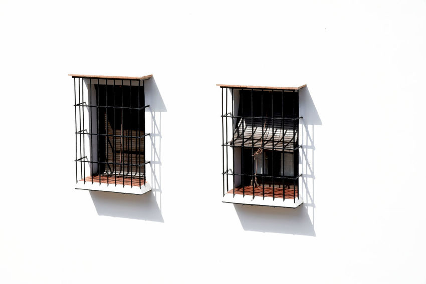 Two Andalusian windows Traditional Decoration Façade White Facade EyeEm Selects Security Bar Residential Building Window House Architecture Building Exterior Built Structure EyeEmNewHere
