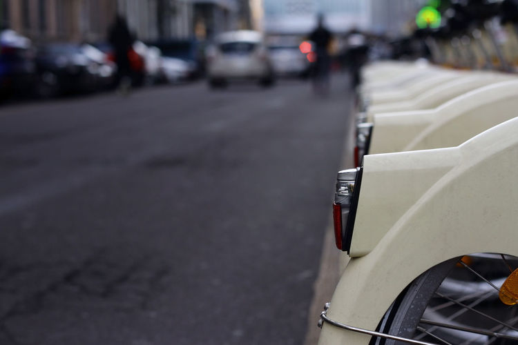 Close-up of cars on street