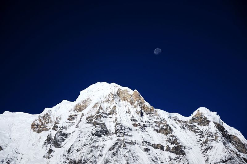 Moon peak. Nepal Himalayas EyeEm Selects Sky Moon Snow Beauty In Nature Scenics - Nature Winter Cold Temperature Mountain Snowcapped Mountain Tranquility Nature Clear Sky Tranquil Scene Blue Astronomy Space Mountain Range Outdoors