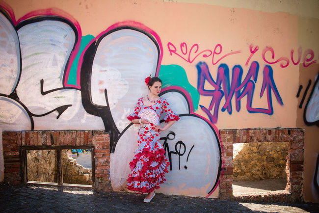 Andalucía Flamenco Spanish Woman Architecture Building Exterior Built Structure Childhood Creativity Day Full Length Graffiti Lifestyles Multi Colored One Person Outdoors People Playing Real People Skill  Street Art Text