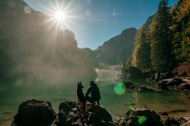My loves. Lens Flare Landscape Nature Sun Fog Outdoors People Sky Day Lake Foggy Beauty In Nature Mountain Scenics Remote Braies Lake Trentino Alto Adige Trentino