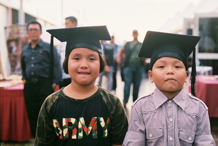 kids with convocation hat EyeEmNewHere Achievement Boys Child Childhood Education Focus On Foreground Front View Graduation Group Of People Looking At Camera Males  Men People Portrait Real People School Smiling Standing Student Teenager