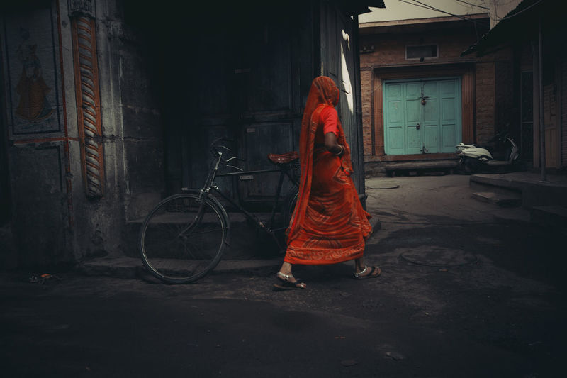 One Person Real People Architecture Full Length Standing Transportation Built Structure Bicycle Building Building Exterior Lifestyles Women Land Vehicle Clothing City Abandoned Leisure Activity Red Side View Hairstyle India Indian Culture  Indian