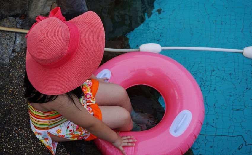 Overhead view of girl in swimming pool
