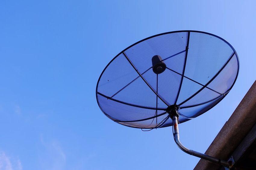 satellite dish on roof with bluesky Satellite Communication Cloud Blue Sky Bluesky Technology Communication Connection Telecommunications Equipment Blue Satellite Dish Clear Sky Day Outdoors Nature Sky