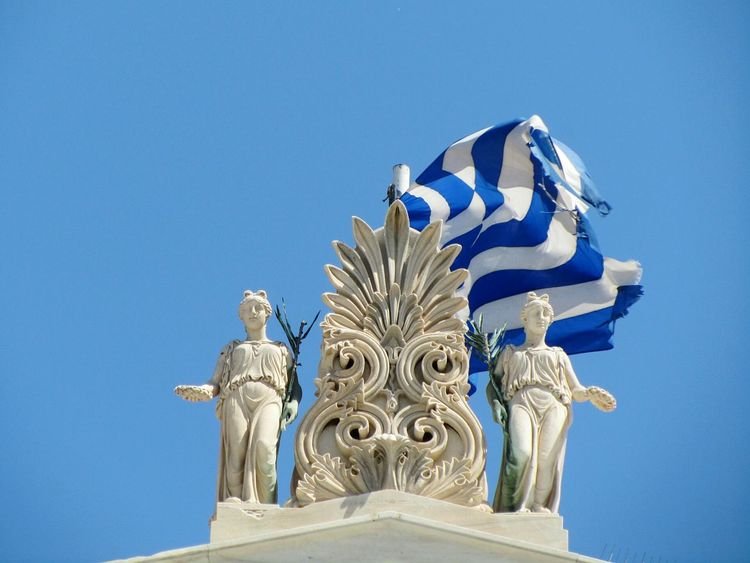 Blue Clear Sky Statue Architecture Flag Windy Day Summertime Travel Destinations Greece EyeEmNewHere From My Point Of View Sightseeing Travel Popular Cityphotography Magazine Mix Yourself A Good Time WeekOnEyeEm Your Ticket To Europe The Week On EyeEm Focus On Details Citysights