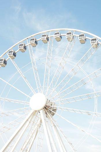 EyeEm Selects Amusement Park Ride Amusement Park Ferris Wheel Sky Arts Culture And Entertainment Low Angle View Fairground Traveling Carnival Cloud - Sky Carnival Nature Leisure Activity Large Circle Blue Geometric Shape Outdoors Day No People Shape