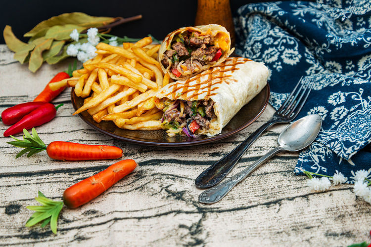 Mexican fajita wraps with grilled chicken fillet and fresh vegetables Wrap Wraps Chicken Food Sandwich Tortilla Healthy Lunch Burrito Mexican Fresh Snack Dinner Fajita Cuisine Lettuce Salad Background Blue Cheese Organic Kebab Meal Table Grilled Food And Drink No People