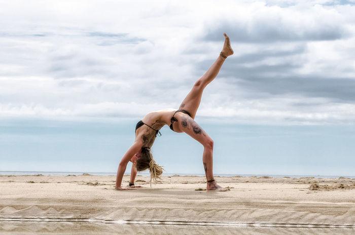 Cloud - Sky Full Length Sky Outdoors Landscape Beach Nature People Day Athlete One Person Adult Yoga Yoga Pose Yogagirl Cornwall Uk Dramatic Sky Sport Spirituality Dicipline Coastline Nature Tattooed Tattooedgirls Tattoo ❤