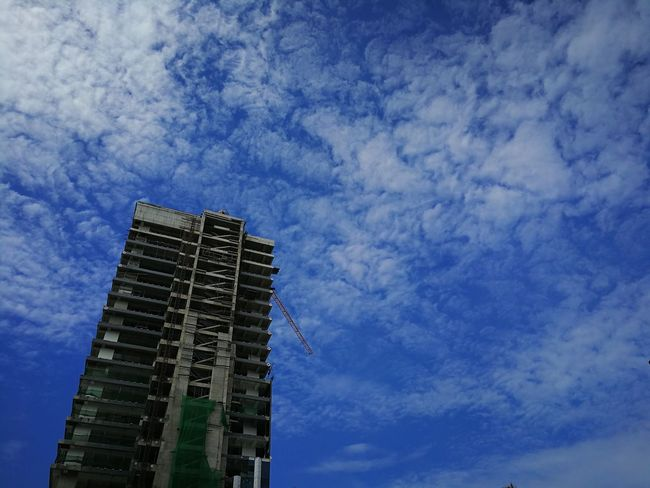 concrete blue.. Mobile Photography Taking Photos Huaweiphotography Smartphone Photography Shotwithhuaweimate9 Huaweimate9 No Edit Huawei Mate 9 Eyeem Philippines City Buildings & Sky Blue Sky And Clouds No People Looking Up Under Construction