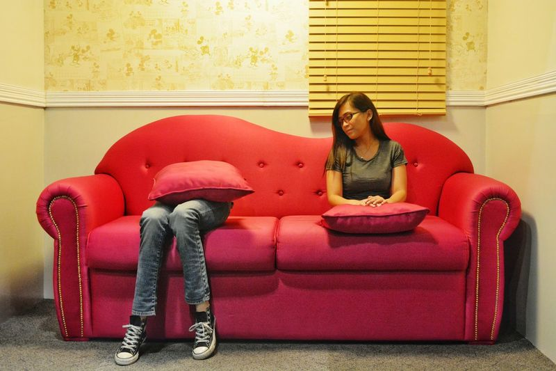Multiple image of woman sitting on sofa