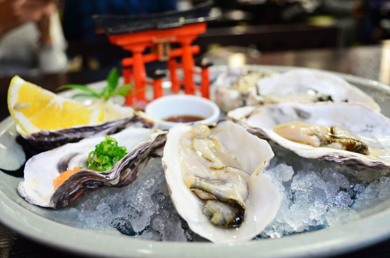 Fresh Oyster Hiroshima -Miyajima Miyajima Seafood Close-up Day Food Food And Drink Fresh Oysters Fresh Oysters And Lemon Freshness Healthy Eating Hiroshima Indoors  No People Oyster  Oyster  Oyster Hiroshia Oyster Miyajima Plate Ready-to-eat Seafood Serving Size Table