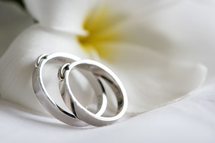 Couple Wedding ring on a white bed. Celebration Celebration Event Close-up Day Diamond Ring Engagement Ring Gold Indoors  Jewelry Life Events Love Luxury No People Platinum Ring Shiny Wedding Wedding Ring White Background White Color