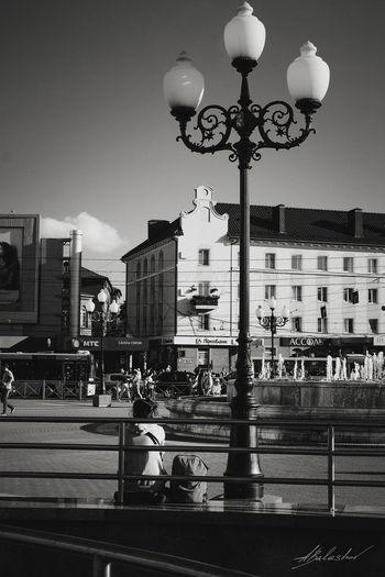 Street light against sky in city