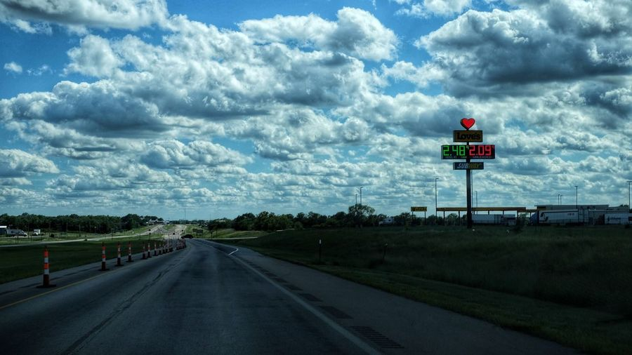 Summertime August 2016 Belleville, Kansas America Camera Work Cloud - Sky Cloudscape Color Photography Cumulus Cloud Diminishing Perspective Driving EyeEm Best Shots Eyeemphoto Fujixt1 Highway Kansas Lifestream On The Road Petrol Station Price Of Gas Road Road Sign Roadtrip Scenics Summertime The Way Forward Tourism Vanishing Point