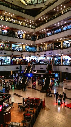 lights Indoors  Transportation Illuminated People Mode Of Transportation Group Of People Travel Shopping Adult Architecture Modern Shopping Mall Incidental People Real People Men Leisure Activity Built Structure Consumerism Sport Ceiling