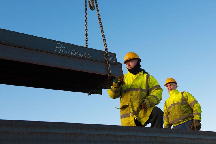 Engineers at work Engineer Engineering Hardhat  Industry Men Protective Workwear Sky Worker First Eyeem Photo