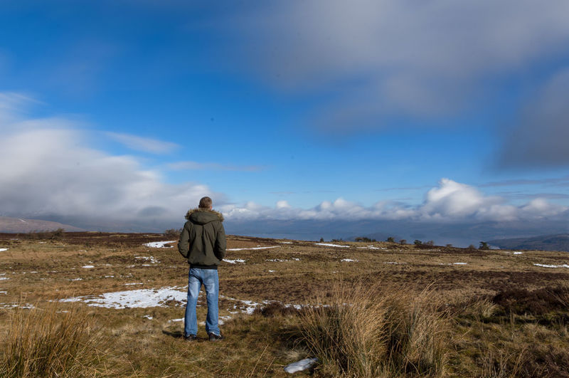 Taking time to enjoy the view Scotland Beauty In Nature Ben Lomond Cloud - Sky Day Full Length Grass Landscape Leisure Activity Lifestyles Loch Lomond Men Mountain Nature One Person Outdoors People Real People Rear View Scenics Sky Standing Tranquil Scene Tranquility Walking