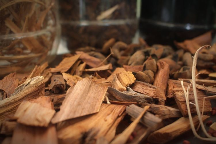 Close-up of firewood in container