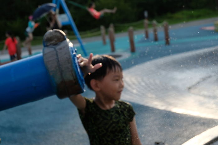 Portrait Boy One Person Playing Water Water Play One Boy Only Outdoor Childhood Children Children Playing Children Photography Playground Fun Water Gun Water Pistol Outdoors Leisure Activity Real People People