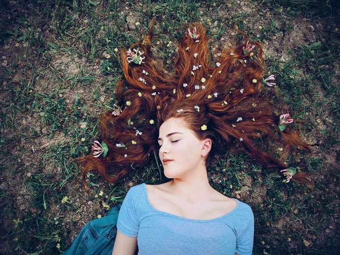 One Person Lifestyles Leisure Activity Real People Front View Young Adult Casual Clothing Eyes Closed  Day Women Nature Lying Down Outdoors High Angle View Plant