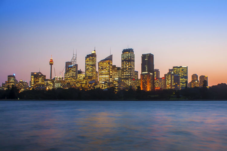 Sunset at Sydney city skyline. Building Exterior Architecture Built Structure Building Sky City Office Building Exterior Skyscraper Water Waterfront Urban Skyline Tall - High Tower Illuminated Landscape Nature No People Cityscape Dusk Modern Outdoors Financial District  Spire