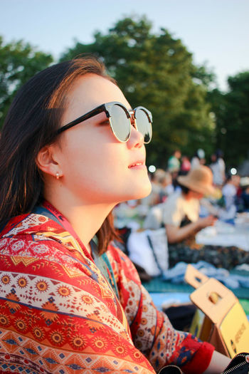 Beautiful Woman Close-up Day Festival Focus On Foreground Hippie Leisure Activity Lifestyles Model One Person Outdoors Portrait Real People Side View Sunglasses Tree Young Adult Young Women