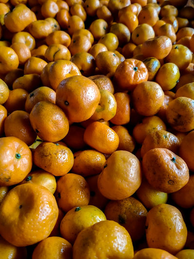 Full frame shot of oranges at market stall