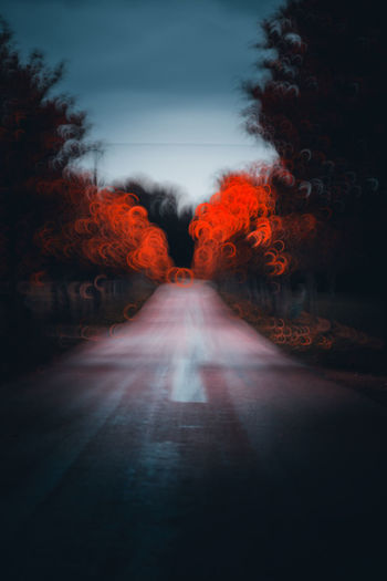 Empty road along trees during autumn